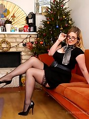 Heidi is in her full festive fetish around the Christmas tree in her lovely black dress, silky...