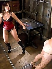 Incredibly sexy Penny Flame does not fuck around when she wants information, and this hapless tourist is no match for her twisted will.   His hard cock only gets him whipped, fucked in the ass, his cock and balls stretched in a brutal CBT scene.  Finally the horny interrogator takes her pleasure and fucks his hard cock and strokes the come out all over her boots, which he eagerly licks up for her.