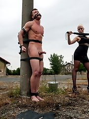 Our eastern European expeditions continue with Mistress Lorelei Lee at an old meat factory in the countryside of the Czech Republic where Fetish Liza, part of our European Divine Bitch sector, has left one lucky euro slave boy naked and bound in the cold for Lorelei to test out. These men have never had women like Mistress Lorelei Lee, a true California beauty, tease their cocks before and their cocks don't lie! With every slash of the whip Ivo just gets harder and harder until he's drooling all over himself. He's made to worship her fine ass in pantyhose and gets strap-on ass fucked and his cock is still hard as a rock! At some point Lorelei decides she must put him through the ultimate challenge and she mummifies him on the train tracks with only his cock and his mouth stuffed with a dildo gag exposed. She rides that dildo on his face so close that he can smell the sex emanating from her delicious cunt. His dick is throbbing at this point but unlucky for him and much to Lorelei's enjoyment the train is coming and either he cums or he is left bound on the tracks for the ultimate denial!