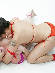 Beaitiful Asian, Milcah Halili has taken some time off but she's back with some training and here in summer vengeance to prove she's a champion. She is taking on the gorgeous big butt, big titted, Blond, Nikki Delano in a 100% real competitive sex fight tournament. Winner fucks the loser so hard her tongue and left hanging out of the side of her mouth. The winner uses the loser tongue to satisfy herself. Loser makes too much noise so she is shut up with a hand gag and a cock in her mouth