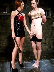 Latex Domina Sara Faye is brand new to MIP and brings a closet full of angst and aggression to take out on Nomad.  After experimenting with an array of painful corporal instruments, the latex clad dominatrix fuck his ass with a huge strap on cock while he is bound tightly to the bed.  He takes it so well that she decides to reward him with her hot, sweaty ass on his face before she fucks his rock hard cock and feeds him his own come.