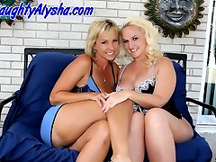 Two smokin hot blondes fist each others pussies.