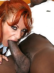 Exotic redheaded hottie fellates a big black cock