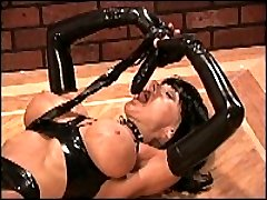 Wild erotic woman poses in black latex outfit