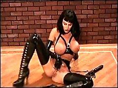 Hardcore lady poses in black latex uniform