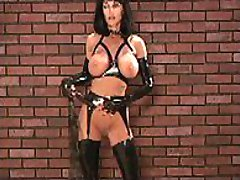 Kinky amateur poses in black shiny latex gear