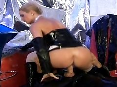She Is Toying With Her Latex Man
