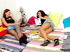 Frisky gals fighting with cushions before kiss-n-lick action through nylon