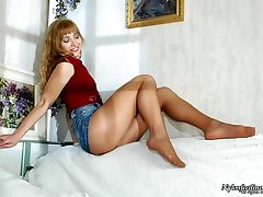 Cutie sensually draping her high heel sandals and demonstrating her nyloned feet