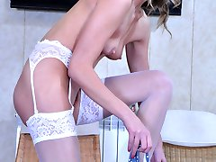 Heated girl slowly strips her polka-dot dress and shiny white lacy nylons