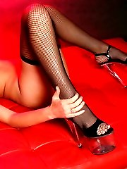 Redhead pornstar Felix Vicious in black fishnet stockings plays with toy