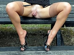 Michelle Manzer loves getting her sexy body and vintage nyloned legs out and about, flashing at...