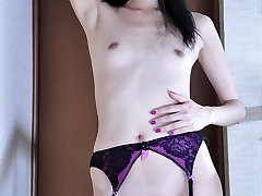Frisky Asian girl in classy black stockings flashing goodies on the stairs