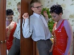 Seductive milf in a red latex dress gives head and gets pounded from behind
