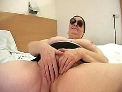 This big titted granny still knows to please herself