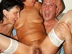 Mature women Marsha and Agnes enjoy a threesome session and take turns in getting their ripe...