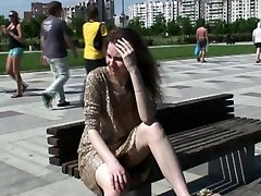She shows her uncovered upskirt on the main square