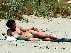 Voyeur photos of nude women on beach