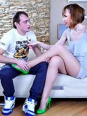 Nasty chick in showy green pumps lures a guy into freakish nylon foot sex