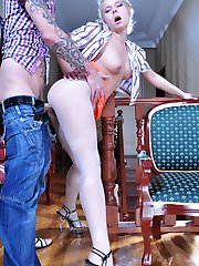 Smoking blonde flashes the top of her white fashion tights and gets dicked
