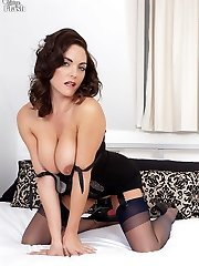 Sweater girl Rebekah taunts and strips down to corselette and nylons