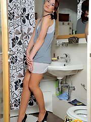 Teen babe home alone strokes her strap-on thru her pantyhose