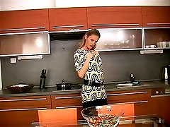 Graceful blonde babe Lenka Janis stripping her sexy dress in the kitchen