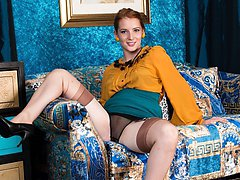 Jessica looks hot in her retro office uniform, sporting some outstanding fully fashioned nylons...