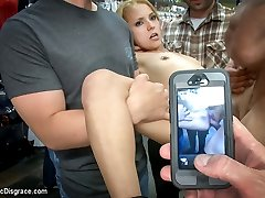 Whats a tiny blonde doing inside of a sleazy sex shop filled with nasty horny guys? Luna Light...