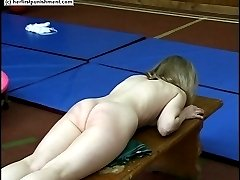 Two naked sweeties caned during exercises in the gym - severe stripes and welts