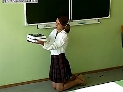 Misbehaving school girl strapped hard across her palms - real tears
