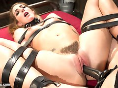 Submissive babe Savannah Fox crawls into Mistress Chanel Preston's dungeon eager to serve. The scene begins when Savannah takes a hard OTK spanking, paddling and finger banging before worshiping her mistress's wet pussy to orgasm! Tied on top of her cage with her legs tied open, Savannah get's fucked with a dick on a stick to multiple squirting orgasms. Finally, Mistress Chanel pussy and anal strap-on fucks her leather strap bound slave for a crescendo of pleasure and pain!