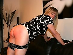Mature blonde flashes off her big well spanked bottom