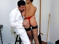Dirty slut in ripped stockings spanked severely and fucked with a dildo inher tight cunt