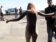 Trussed naked in public and hosed down