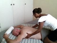 Ebony masseus paid to give happy finishing massage fuck