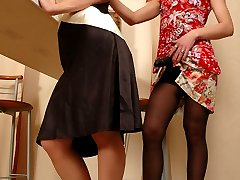 Nasty brunette in black pantyhose fucking her female friend with a strap-on