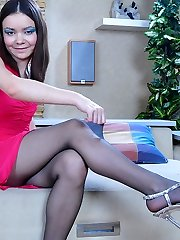 Naughty flasher spreads pussy lips thru the opening in barely black tights