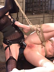 Dominatrix legends Maitresse Madeline and Aiden Starr unleash their cruelest impulses to haze gorgeous up-and-coming dominatrix porn star Mona Wales! Mona endures unrestrained kinky lesbian passion including, spanking, flogging, pussy licking, scissoring, bondage, pussy and anal fisting, pussy and anal strap on fucking and intense squirting orgasms! Watch Mona earn her place as a supremely bad ass bitch!
