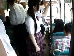 Japanese AV Model in uniform travels next to PublicSexJapan.com