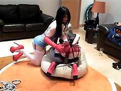Kirsty is dressed up as a Latex Nurse and she is giving a horny blonde a check up with her cock.