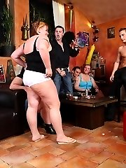 The BBW orgy starts off with people getting naked and dicks being sucked by horny chubs