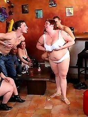 Horny fat chick gets naked in the bar and they have their fun fucking her hot body