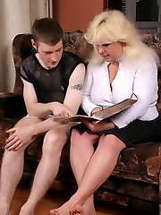 Mature blonde plumper gags on a firm swarthy sausage