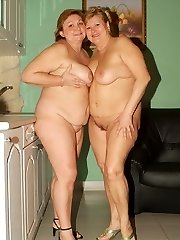 Anna and Yolanda are horny mature plumpers enjoying a super-cute lesbian scene in the kitchen