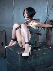 Milcah Halili is as packaged up in chain bondage as they are wrapped around O.T.'s finger, and that's right where he wants them. He turns Milcah over back and forth so he can access whichever of their holes he wants to pound with a metal hook or beat with his variety of crops. Milcah doesn't know whether they love it or hate it, but whatever that perceiving is, they're feeling a pile.