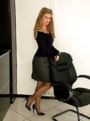 Leggy Kathryn shows her gorgeous black nylon legs and tall shiny stilettos, as she struts around...