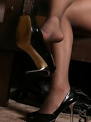 Jade, sitting in a throne wearing nothing but thigh high stockings, smacks her foot slave with a...