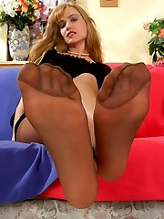 Lewd gal stroking her curves before sliding dildo under pantyhose waistband