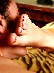 Young bound slave fails to please his domina with skillful toe-licking and gets treated with a...
